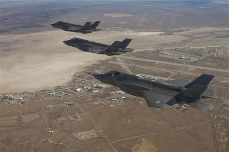 Three F-35 Joint Strike Fighters (rear to front) AF-2, AF-3 and AF-4, can be seen flying over Edwards Air Force Base in this December 10, 2011 handout photo provided by Lockheed Martin. REUTERS/Lockheed Martin/Darin Russell/Handout