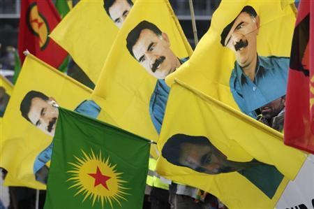 Kurdish demonstrators hold flags with portraits of jailed Kurdistan Workers Party (PKK) leader Abdullah Ocalan in front of the European Parliament in Strasbourg February 16, 2012. REUTERS/Vincent Kessler