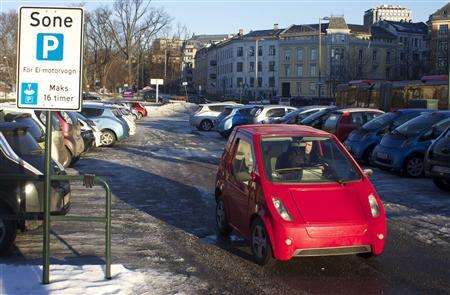 A driver leaves a free car park reserved for electric vehicles in Oslo February 25, 2013. Norway's buzzing little market for pure electric cars has in its very success shown the severe drawbacks to a model that relies on public subsidies worth as much as $8,200 per car, every year. Picture taken February 25, 2013. REUTERS/Alister Doyle