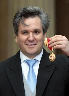 Royal Opera House Music Director, Antonio Pappano, poses with his Knighthood after being knighted by Britain's Prince Charles at Buckingham Palace in London May 15, 2012. REUTERS/Sean Dempsey/pool