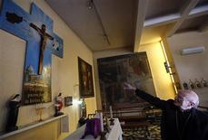 Father Giuseppe Moretti gestures at a Catholic Church in Kabul March 13, 2013. REUTERS/Mohammad Ismail