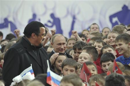 Russian President Vladimir Putin (R) and actor Steven Seagal (L) visit a new sports arena on the territory of the Sambo-70 training sports complex in Moscow, March 13, 2013. REUTERS/Aleksey Nikolskyi/RIA Novosti/Pool