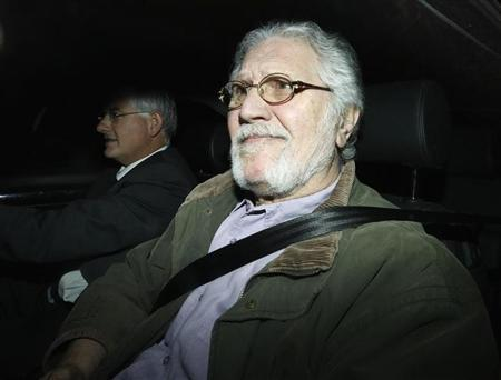 Former BBC presenter Dave Lee Travis returns to his house in Mentmore, southern England November 15, 2012. REUTERS/Olivia Harris
