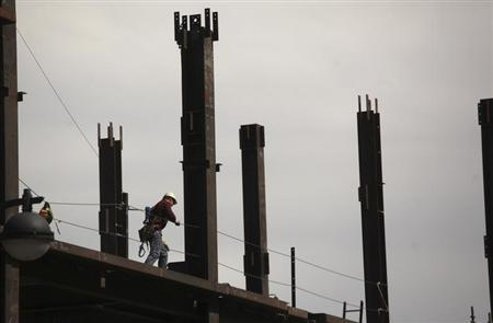 A construction worker performs labor at a residential building project in the China Basin area in San Francisco, California March 8, 2013. REUTERS/Robert Galbraith