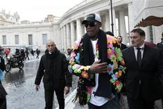 Former basketball star Dennis Rodman, a five-times NBA champion, walks outside Saint Peter's Square at the Vatican March 13, 2013. REUTERS/Giampiero Sposito