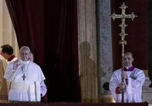 Newly elected Pope Francis, Cardinal Jorge Mario Bergoglio of Argentina appears on the balcony of St. Peter's Basilica after being elected by the conclave of cardinals, at the Vatican, March 13, 2013. REUTERS/Max Rossi
