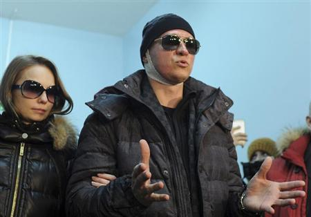 Sergei Filin, artistic director of Russia's Bolshoi Ballet, speaks to journalists as he leaves a hospital accompanied by his wife Maria (L) in Moscow February 4, 2013. REUTERS/Vselovod Kutznestov