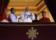 Newly elected Pope Francis (C), Cardinal Jorge Mario Bergoglio of Argentina appears on the balcony of St. Peter's Basilica after being elected by the conclave of cardinals, at the Vatican, March 13, 2013. REUTERS/Tony Gentile