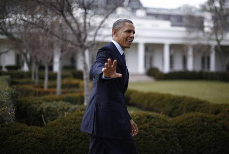 U.S. President Barack Obama walks in the Rose Garden of the White House in Washington, March 13, 2013, upon his return from a meeting at the U.S. Capitol Building with House Republicans on a budget deal. REUTERS/Jason Reed