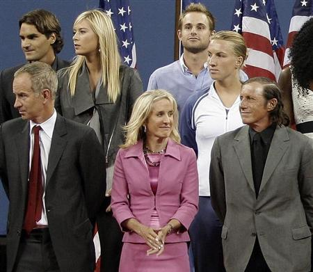 Former U.S. Open champion Tracy Austin (Bottom C) is seen with other champions during the Opening ceremony of the U.S. Open tennis tournament in Flushing Meadows, New York in this August 25, 2008 file photo. REUTERS/Kevin Lamarque/Files