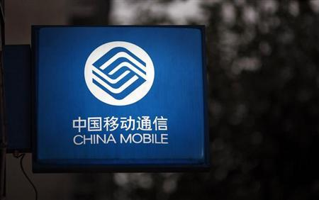 A sign with the logo of China Mobile at a downtown area of Shanghai October 22, 2012. REUTERS/Carlos Barria/Files