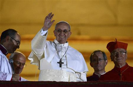 Newly elected Pope Francis, Cardinal Jorge Mario Bergoglio of Argentina appears on the balcony of St. Peter's Basilica after being elected by the conclave of cardinals, at the Vatican, March 13, 2013. REUTERS/Dylan Martinez