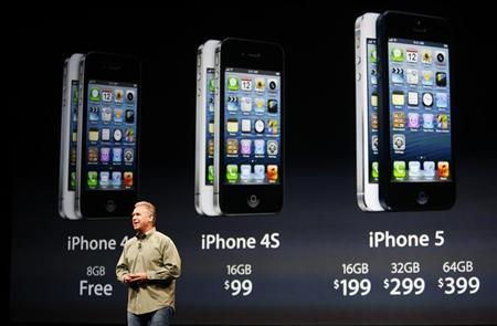 Phil Schiller, senior vice president of worldwide marketing at Apple Inc, speaks about iPhone 5 pricing during Apple Inc.'s iPhone media event in San Francisco, California September 12, 2012. REUTERS/Beck Diefenbach