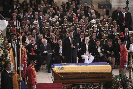 Venezuela's Vice-President Nicolas Maduro (C) speaks during the funeral service for late President Hugo Chavez at the Military Academy in Caracas March 8, 2013, in this picture provided by the Miraflores Palace. REUTERS/Miraflores Palace/Handout