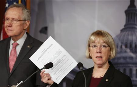 Senate Budget Committee chair Senator Patty Murray holds up a copy of a federal employees' Worker Adjustment and Retraining Notification (WARN) at a news conference on Capitol Hill in Washington February 28, 2013. REUTERS/Larry Downing