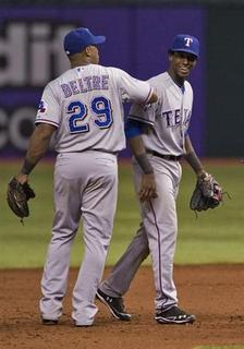 Texas Rangers' Adrian Beltre (L) celebrates with Jurickson Profar (R) after a ten inning, 4-2 win over the Tampa Bay Rays during a MLB American League baseball game in St. Petersburg, Florida, September 8, 2012. REUTERS/Steve Nesius