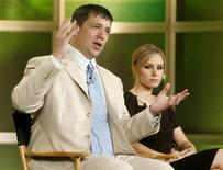 Actress Kristen Bell (R), star of The CW network's program 'Veronica Mars', and creator and executive producer of the series Rob Thomas take part in a panel discussion at the Television Critics Association press tour in Pasadena, California July 17, 2006. REUTERS/Fred Prouser