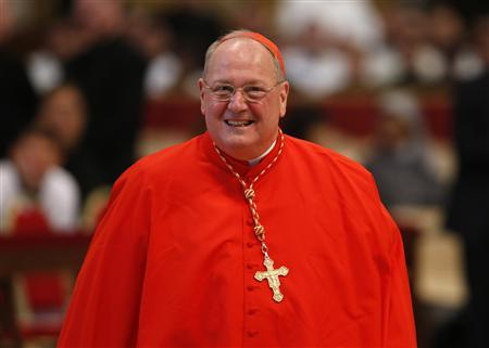 Cardinal Timothy Michael Dolan of the U.S. attends a mass in St. Peter's Basilica at the Vatican March 12, 2013. REUTERS/Stefano Rellandini