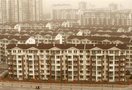 New apartment buildings where the local government built homes for former miners and farmers as part of an urbanisation programme, are seen in Mentougou district, suburb of Beijing, February 28, 2013. REUTERS/Kim Kyung-Hoon/Files
