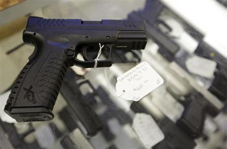 A hand gun, very similar to the gun used by alleged gunman Wade Michael Page, is seen at The Shooter Shop, where Page purchased the weapon, in West Allis, Wisconsin, August 7, 2012.d. REUTERS/John Gress (