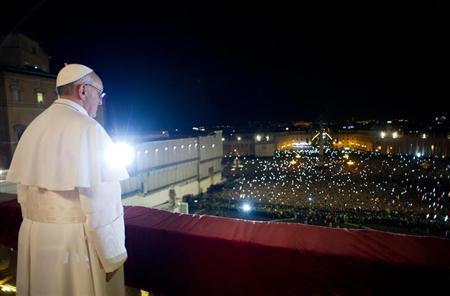 Newly elected Pope Francis I, Cardinal Jorge Mario Bergoglio of Argentina appears on the balcony of St. Peter's Basilica after being elected by the conclave of cardinals, in a photograph released by Osservatore Romano at the Vatican, March 13, 2013. REUTERS/Osservatore Romano