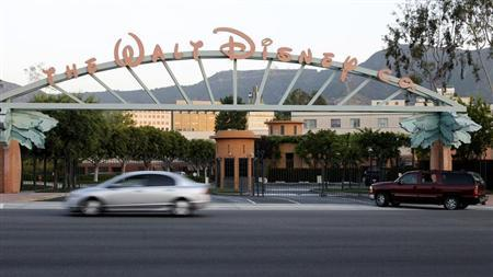 The signage at the main gate of The Walt Disney Co. is pictured in Burbank, California, May 7, 2012. Walt Disney Co's quarterly earnings beat Wall Street expectations as profit rose 21 percent despite a loss from the science fiction film bomb ''John Carter.'' Picture taken May 7, 2012. REUTERS/Fred Prouser