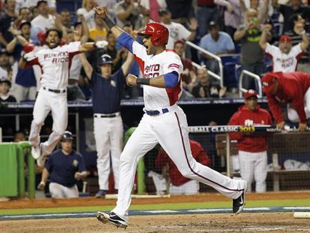 Puerto Rico's Alex Rios crosses the plate to scoring the go-ahead run in the eighth inning against Italy in a 2013 World Baseball Classic game at Marlins Stadium in Miami, Florida March 13, 2013. REUTERS/Andrew Innerarity
