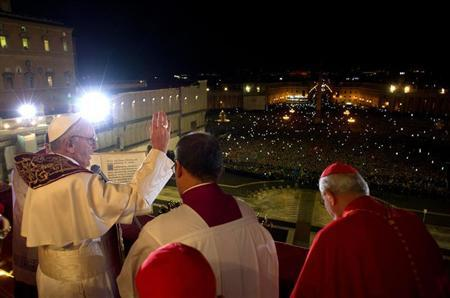 Newly elected Pope Francis I (L), Cardinal Jorge Mario Bergoglio of Argentina appears on the balcony of St. Peter's Basilica after being elected by the conclave of cardinals, in a photograph released by Osservatore Romano at the Vatican, March 13, 2013. REUTERS/Osservatore Romano
