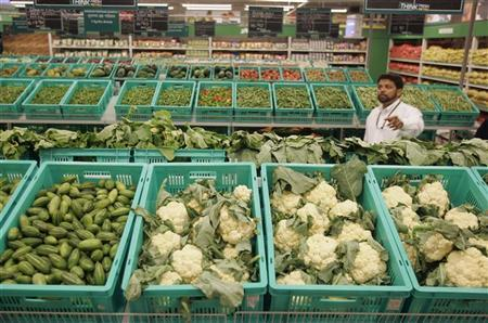 A worker works at a newly-opened Metro cash-and-carry outlet in Kolkata December 3, 2008. REUTERS/Parth Sanyal/Files