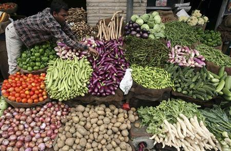 A vendor arranges vegetables at a market in Jammu August 12, 2009. REUTERS/Mukesh Gupta/Files