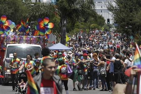 Crowds of revellers pack Santa Monica Blvd during the LA Pride parade in West Hollywood, California, June 10, 2012. The parade is part of the annual Los Angeles lesbian, gay, bisexual and transgender pride celebration in West Hollywood. REUTERS/Jonathan Alcorn