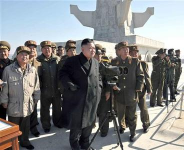 North Korean leader Kim Jong-un (C) and military officers watch a live shell firing drill to examine war fighting capabilities of artillery sub-units, whose mission is to strike Daeyeonpyeong island and Baengnyeong island of South Korea, in the western sector of the front line in this picture released by the North's official KCNA news agency in Pyongyang March 14, 2013. REUTERS/KCNA