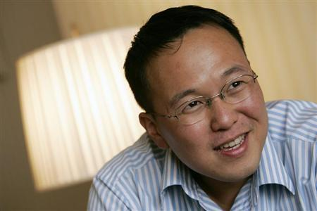 Malaysian writer Tan Twan Eng smiles during an interview in Hong Kong March 5, 2008. REUTERS/Bobby Yip