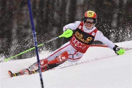 Marcel Hirscher of Austria clears a gate during his first run of the men's Slalom event at the Alpine Skiing World Cup in Kranjska Gora March 10, 2013. REUTERS/Srdjan Zivulovic