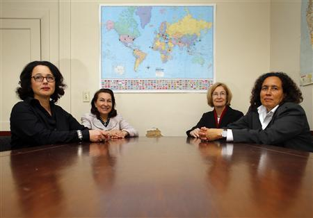 (L-R) Jessica Stern, fellow at the Hoover Institution, Linda J. Bilmes, professor at Harvard University's Kennedy School, Catherine Lutz, professor at Brown University's Institute for International Studies, and Neta Crawford, professor of political science at Boston University, pose for a photograph in Boston, Massachusetts March 12, 2013. REUTERS/Brian Snyder