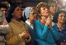 "Roman Catholic faithful pray during the first mass to celebrate the election of Argentine Cardinal Jorge Bergoglio as the new Pope, in the Metropolitan Cathedral in Buenos Aires, March 13, 2013. Pope Francis, the former Cardinal Jorge Bergoglio, delivered his first blessing to a huge crowd in St Peter's Square on Wednesday night, asking for the prayers of ""all men and women of good will"" to help him lead the Catholic Church. REUTERS/Agustin Marcarian"