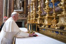 Newly elected Pope Francis I, Cardinal Jorge Mario Bergoglio of Argentina, makes a private visit to the 5th-century Basilica of Santa Maria Maggiore, in a photo released by Osservatore Romano in Rome March 14, 2013. Pope Francis, barely 12 hours after his election, quietly left the Vatican early on Thursday to pray for guidance as he looks to usher a Roman Catholic Church mired in intrigue and scandal into a new age of simplicity and humility. REUTERS/Osservatore Romano