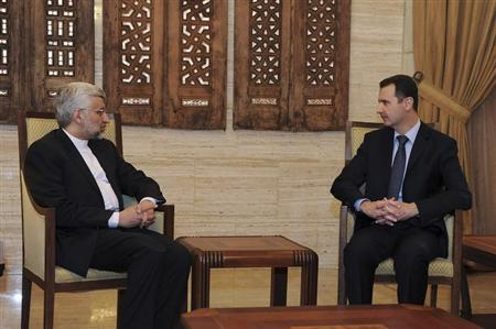 Syria's President Bashar al-Assad (R) meets Iran's Supreme National Security Council Secretary Saeed Jalili in Damascus February 3, 2013, in this handout photograph released by Syria's national news agency SANA. REUTERS/Sana