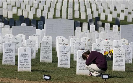 Iraq war widow Sheryl McIlvaine visits the grave of her husband, U.S. Marine Sgt. James R. McIlvaine, in Section 60 at Arlington National Cemetery in Virginia, in this October 19, 2009 file photo. REUTERS/Larry Downing/Files