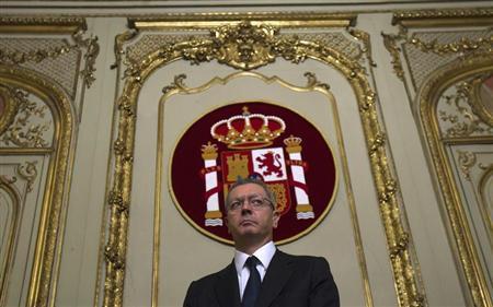 Spain's Justice Minister Alberto Ruiz Gallardon looks on at the Justice Ministry after receiving the portfolio in Madrid, December 22, 2011. REUTERS/Juan Medina