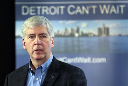 Michigan Governor Rick Snyder talks about the city of Detroit being in a financial emergency state during a meeting with an invited audience at Wayne State University in Detroit, Michigan, March 1, 2013. REUTERS/ Rebecca Cook