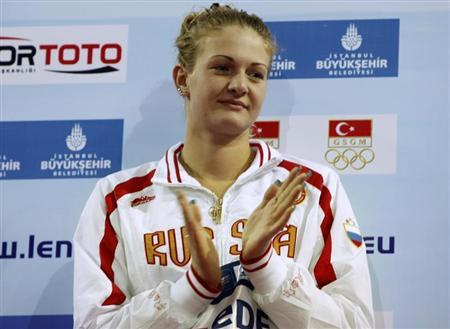 Ksenia Moskvina of Russia gestures during the medal ceremony for the women's 100m backstroke final at the European Short Course Swimming Championships in Istanbul December 11, 2009. REUTERS/Osman Orsal