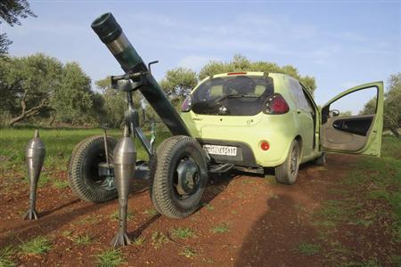 A mortar that belongs to the Free Syrian Army fighters, is pictured attached to a car to be pulled to the front line where clashes with forces loyal to Syria's President Bashar al-Assad are taking place, in Binnish in Idlib province March 13, 2013. REUTERS/Mohamed Kaddoor/Shaam News Network/Handout