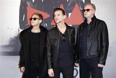 From L-R, Martin Gore, Dave Gahan and Andrew Fletcher of British band Depeche Mode pose during a photocall before a press conference in Paris to announce the dates for their 2013/2014 world tour October 23, 2012. REUTERS/Benoit Tessier