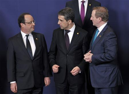 France's President Francois Hollande (L), his Bulgarian counterpart Rosen Plevneliev (C) and Ireland's Prime Minister Enda Kenny attend a European Union leaders summit in Brussels March 14, 2013. European leaders gathered in Brussels on Thursday with differences over austerity and how best to tackle the social costs of the debt crisis set to dominate their two-day summit. REUTERS/Eric Vidal