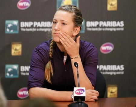 Victoria Azarenka of Belarus talks about withdrawing from the tournament due to a right ankle injury before her quarterfinal match against Caroline Wozniacki of Denmark at the BNP Paribas Open WTA tennis tournament in Indian Wells, California, March 14, 2013. REUTERS/Danny Moloshok