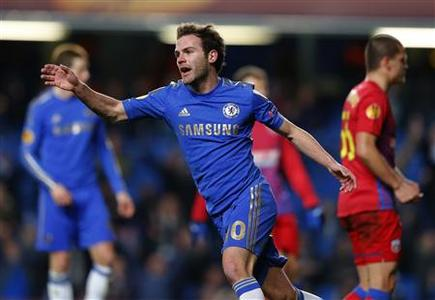 Juan Mata of Chelsea celebrates scoring against Steaua Bucharest during their Europa League match at Stamford Bridge in London, March 14, 2013. REUTERS/Andrew Winning