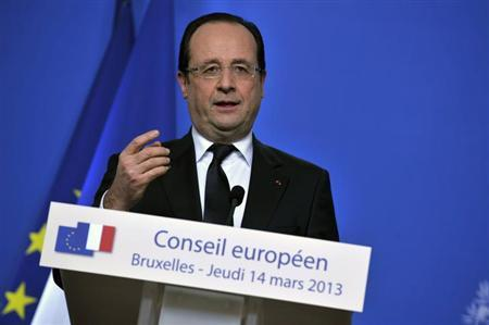 France President Francois Hollande holds a news conference during a European Union leaders meeting in Brussels March 14, 2013. REUTERS/Eric Vidal