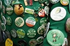St. Patrick's Day coat pins adorn the jacket of Dennis Dunn of New York as he watches the 251st annual St. Patrick's Day Parade in New York, March 17, 2012. REUTERS/Carlo Allegri