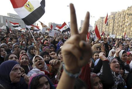 Women shout during a protest in Tahrir Square in Cairo January 25, 2013. REUTERS/Mohamed Abd El Ghany/Files